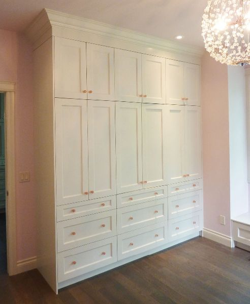Custom storage cabinets for a girls room. Pink accent handles make ...