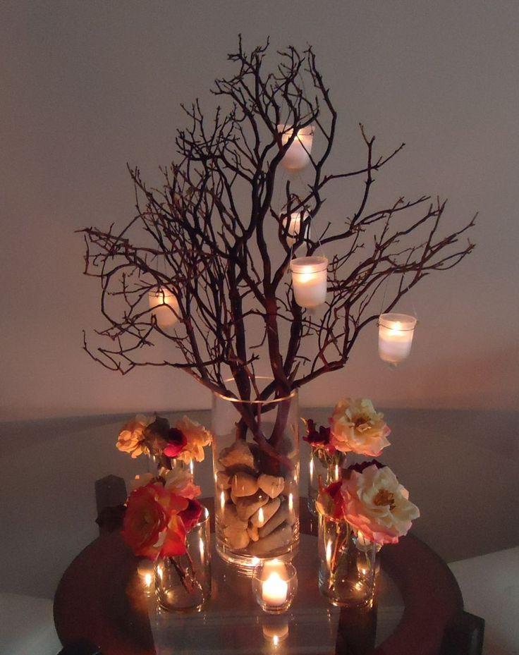 Branch centerpiece with hanging votives Branch centerpiece