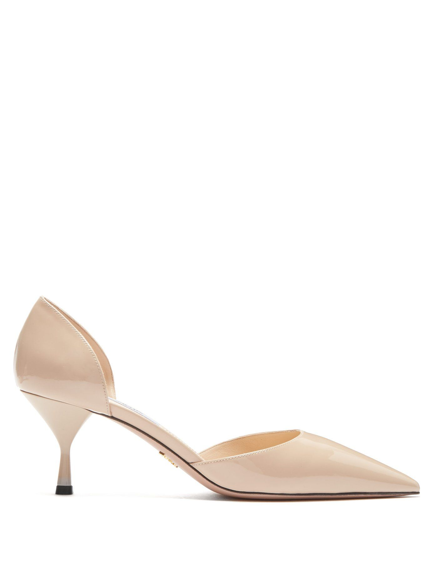 6921d10e1ef These beige-pink patent leather d Orsay pumps from Prada encapsulate the  refined Italian