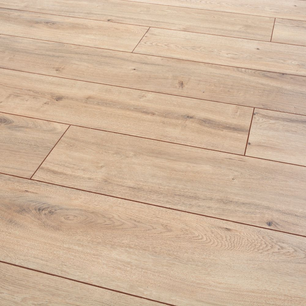 Smooth Texture And Coloration Clarion Tacoma Oak Has A Traditional Warm Feel For Any Home The Paint Oak Laminate Flooring Oak Laminate Wood Floors Wide Plank