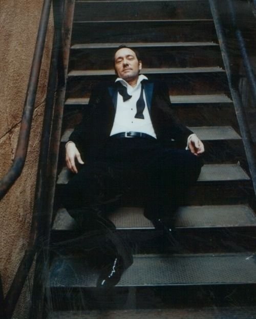 Mmmmm yes, Mr. Spacey in a suit, spread out on the staircase.....