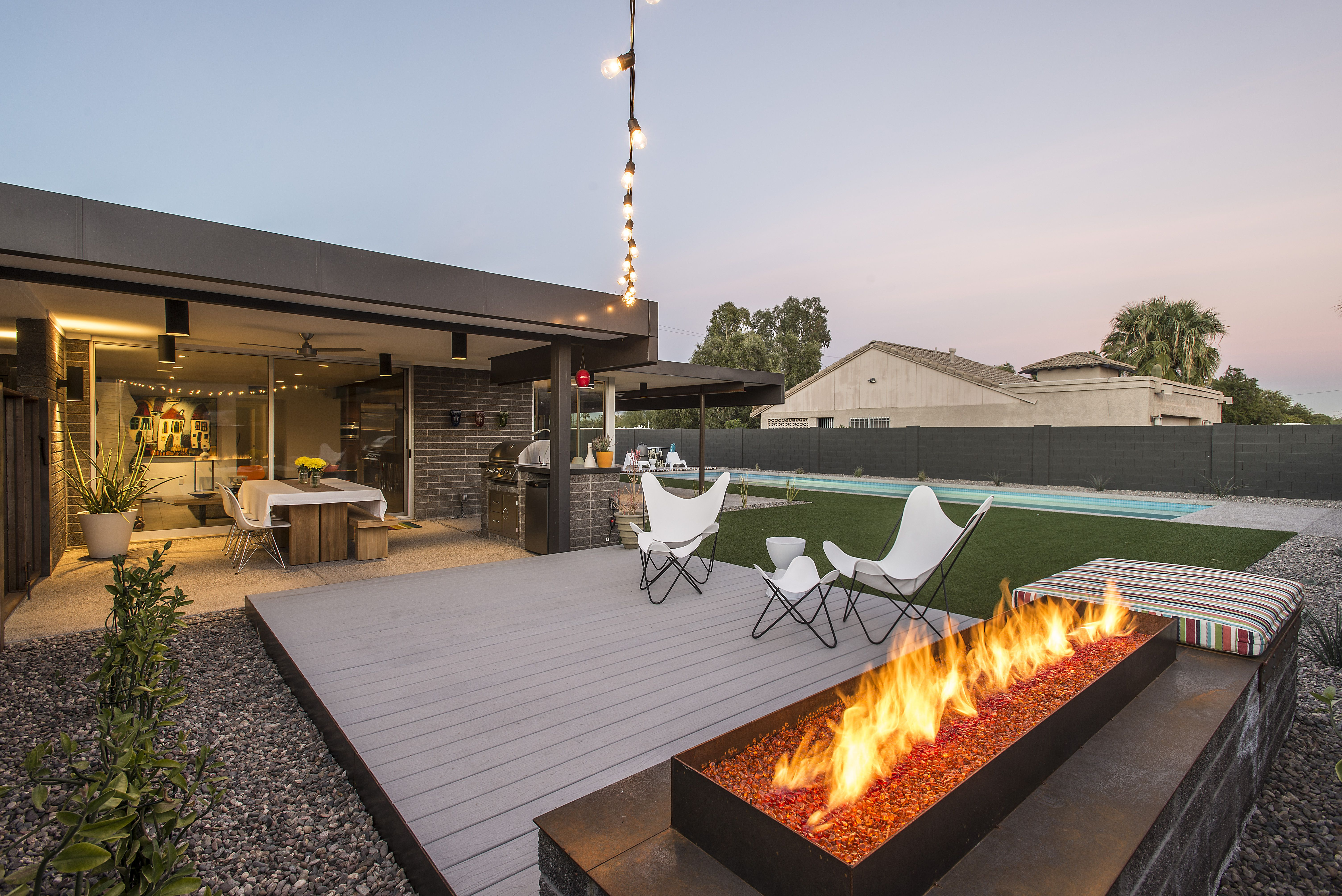 Linear fire pit and raised posite deck was incorporated into this