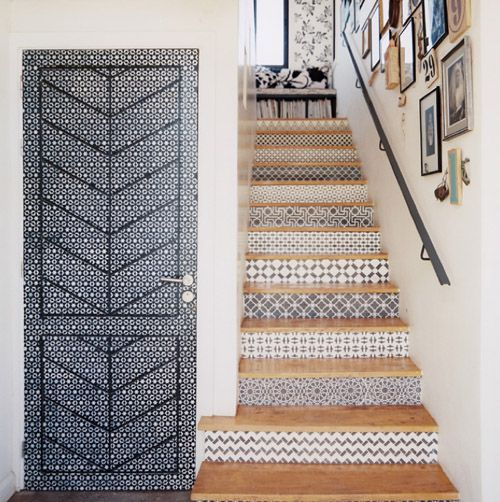 Tiles stairs and door. Tile sliding closet doors at top of stairs
