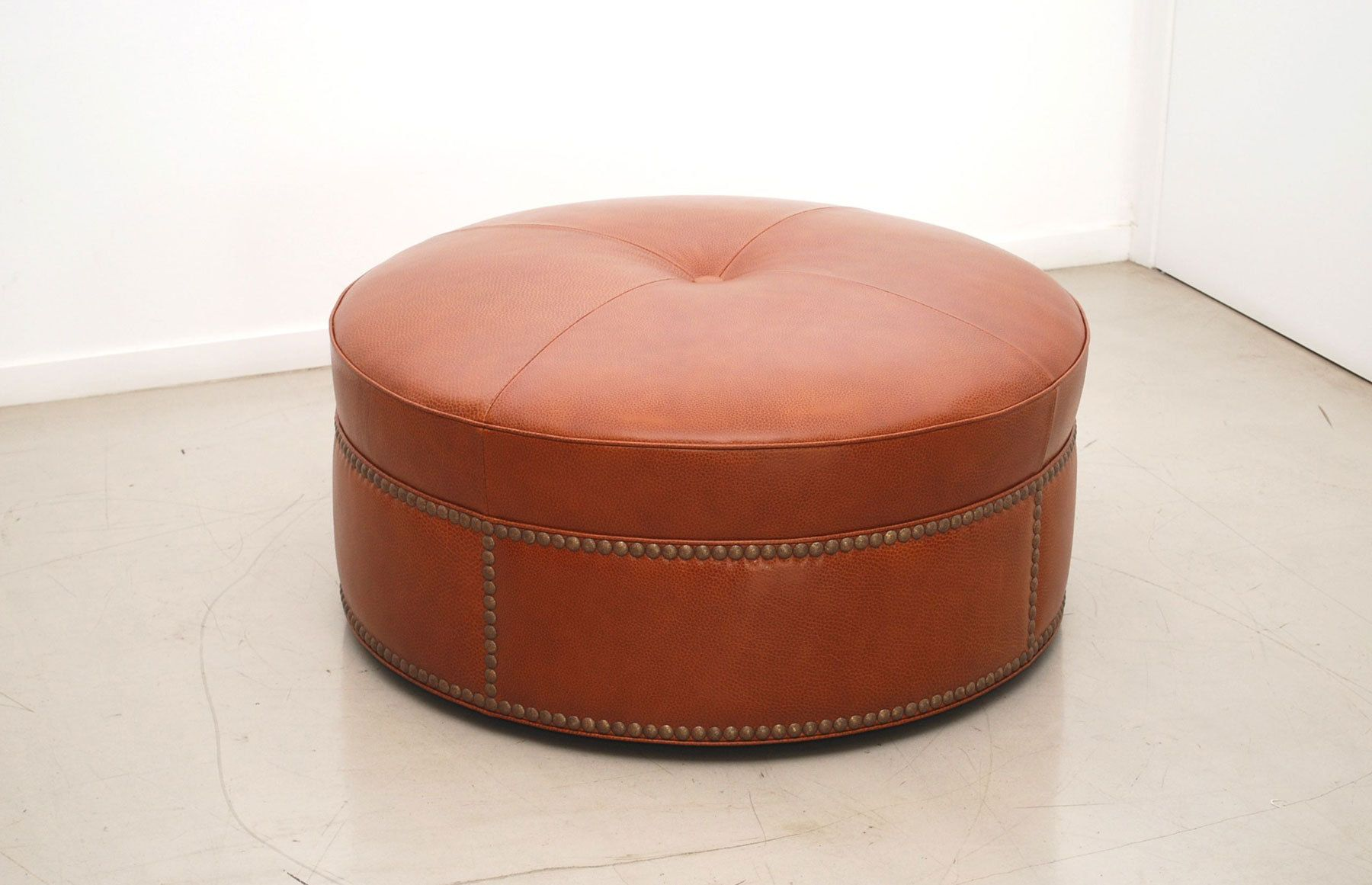 Furniture Brown Leather Round Ottoman With Cream Stitching Thread On Ceramics Flooring Wonderful Looks Of Large Round Ottoman Perfecting Living Room Decoratio