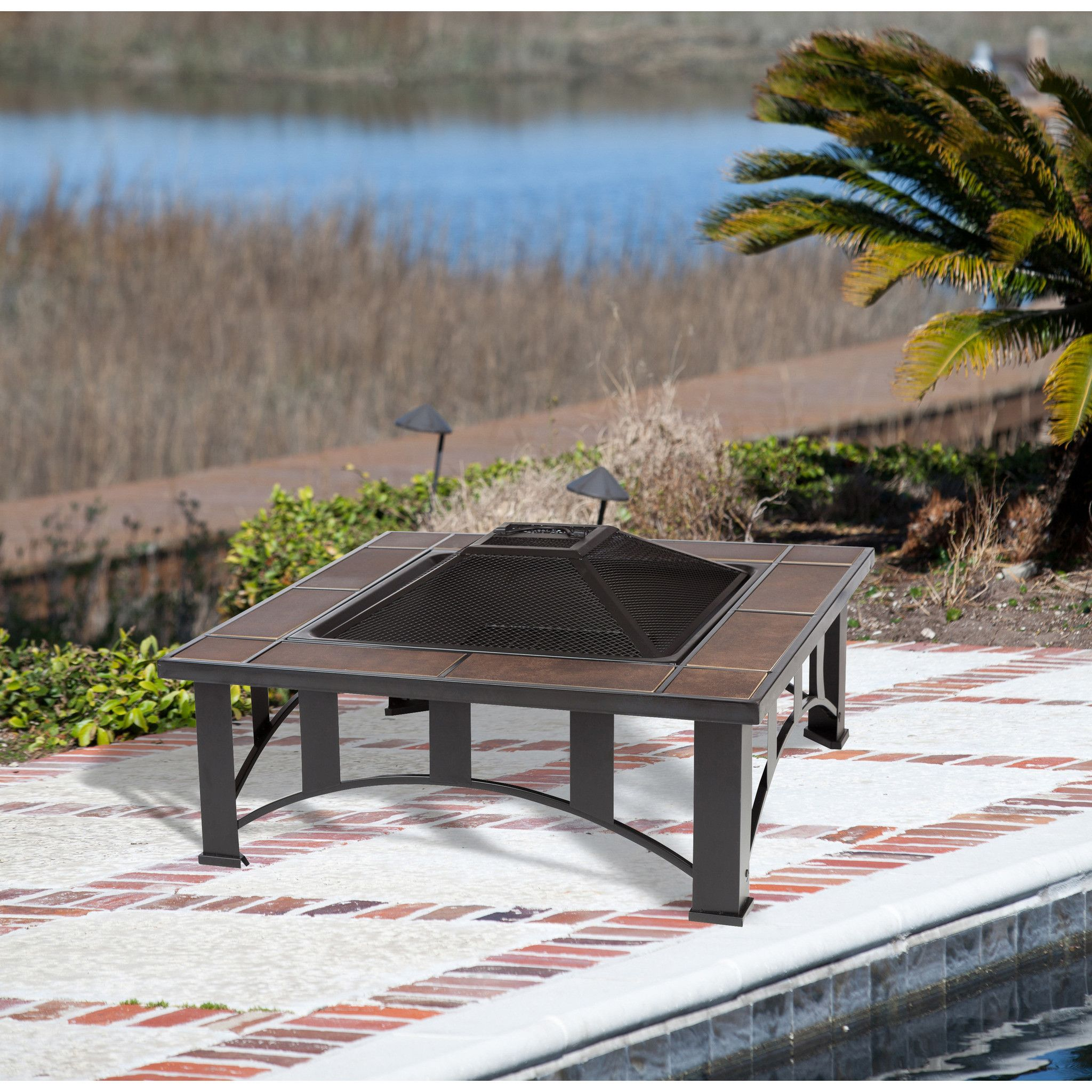 square tuscan tile top mission style fire pit featuring the look of