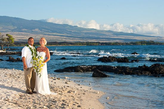 Hawaii wedding just past the Marriot Resort.  Hualalai mountain in the background.  The Beach is A-Bay.  www.eyeexpression.com