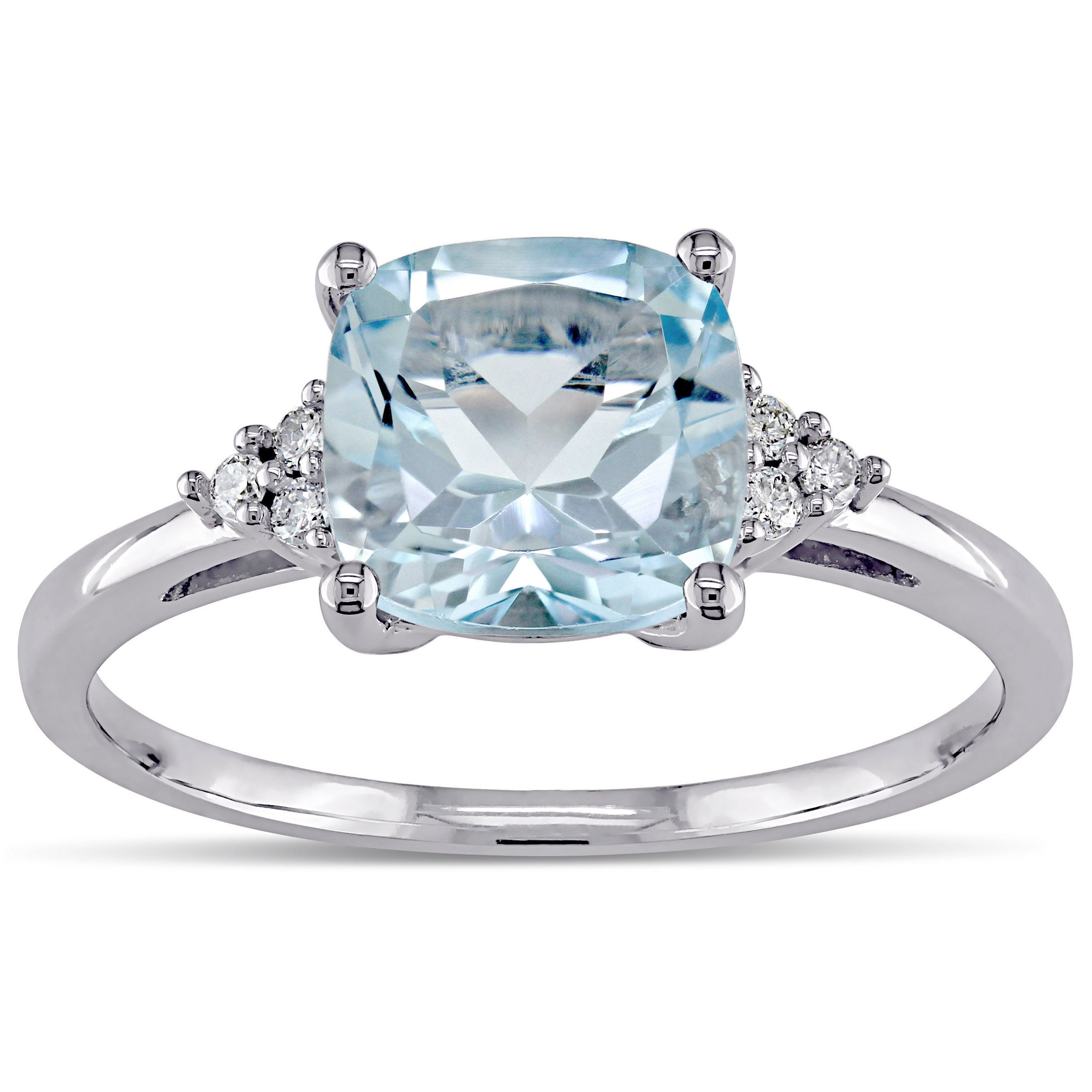 A stunning, square-cut blue topaz is prong-set in 10-karat white ...