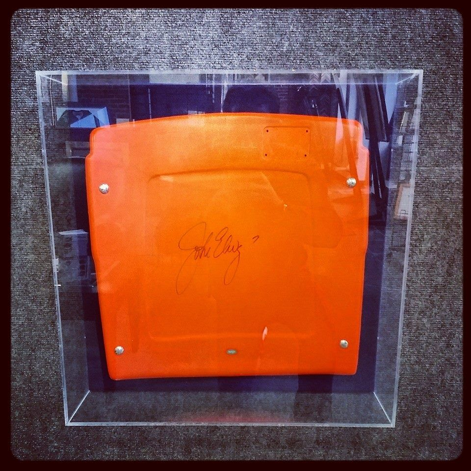 Old Mile High Stadium seat signed by the one and only