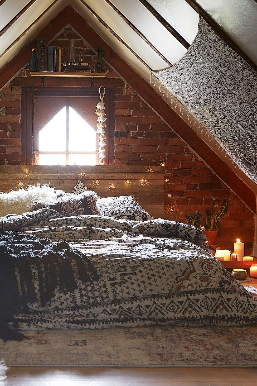 Boho loft bedroom  Taylorus example room Wood lights low bed rug and tapestry as an