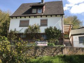 Einfamilienhaus mit Garage Einfamilienhaus, Wolle kaufen