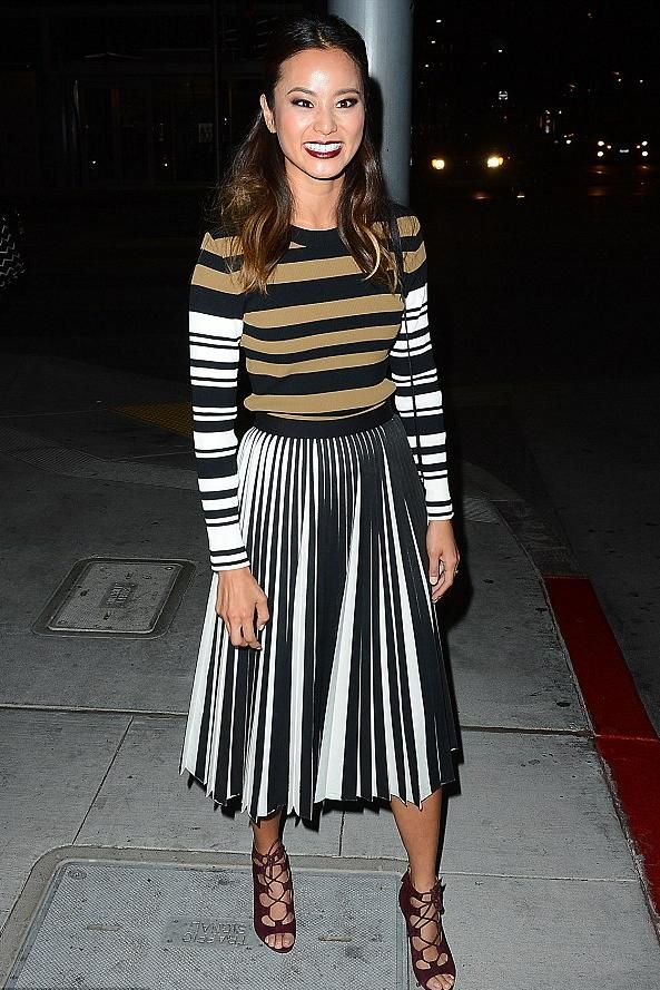 Jamie Chung wearing Proenza Schouler Pleated-Front Skirt and Givenchy Multi-Stripe Sweater