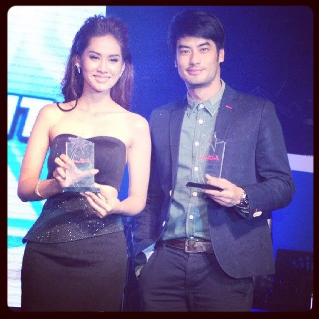 Boy and some girl with his award :)