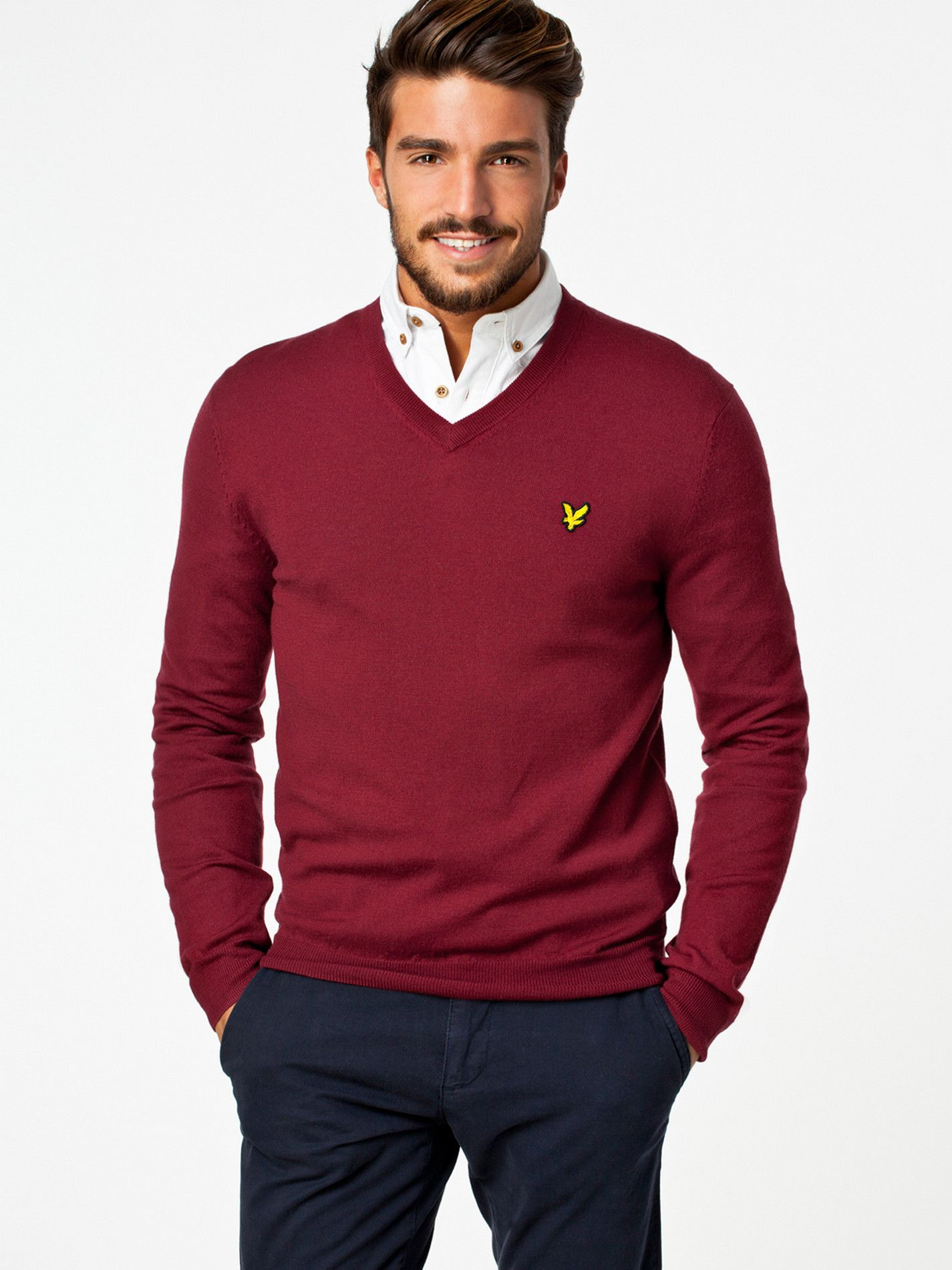 Classic British style, red Lyle and Scott jumper paired with a white shirt  and navy chinos