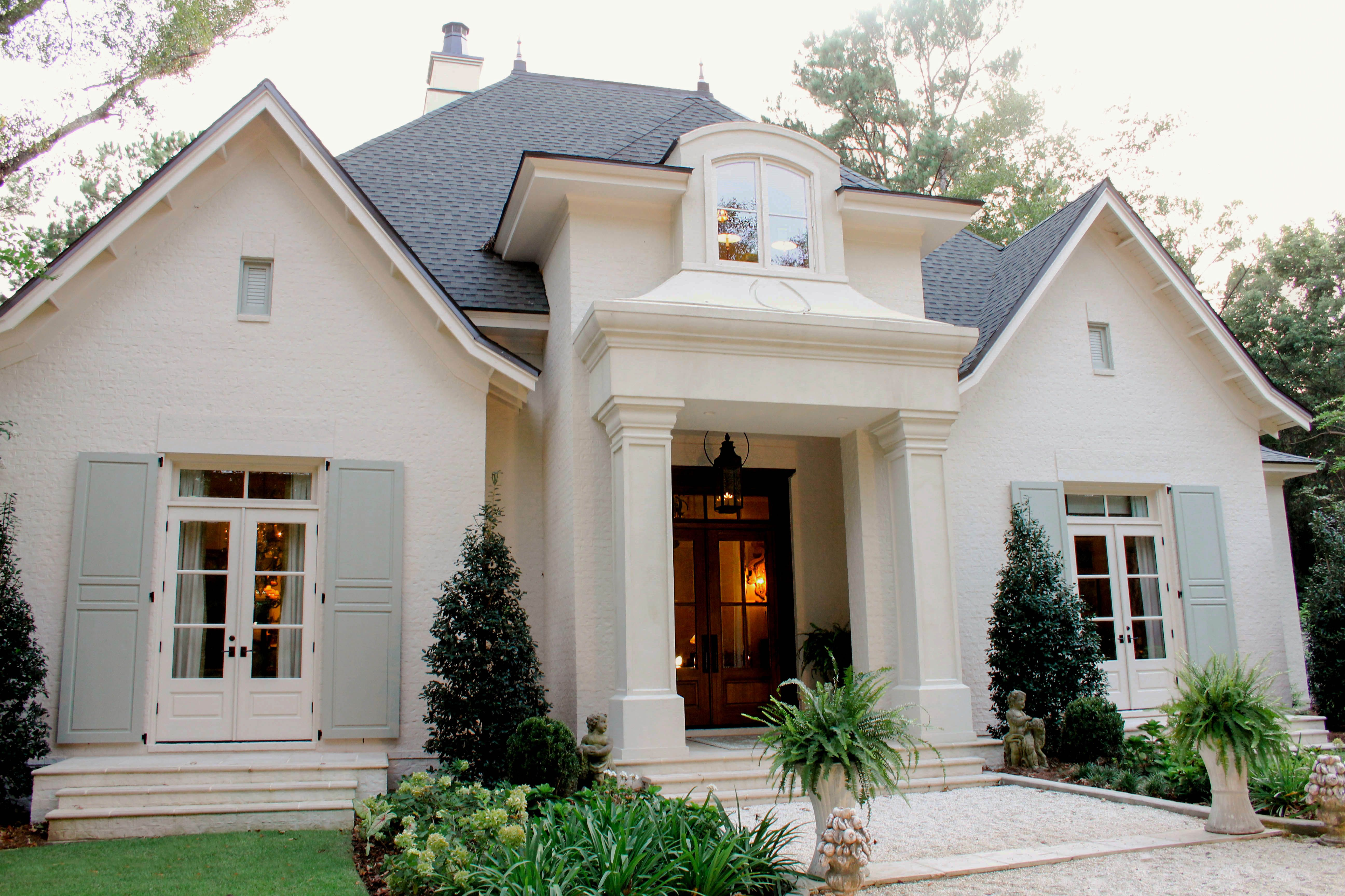 Charming French Country Cottage Designed By Bob Chatham Brick Exterior House French Cottage Exterior White Stucco House