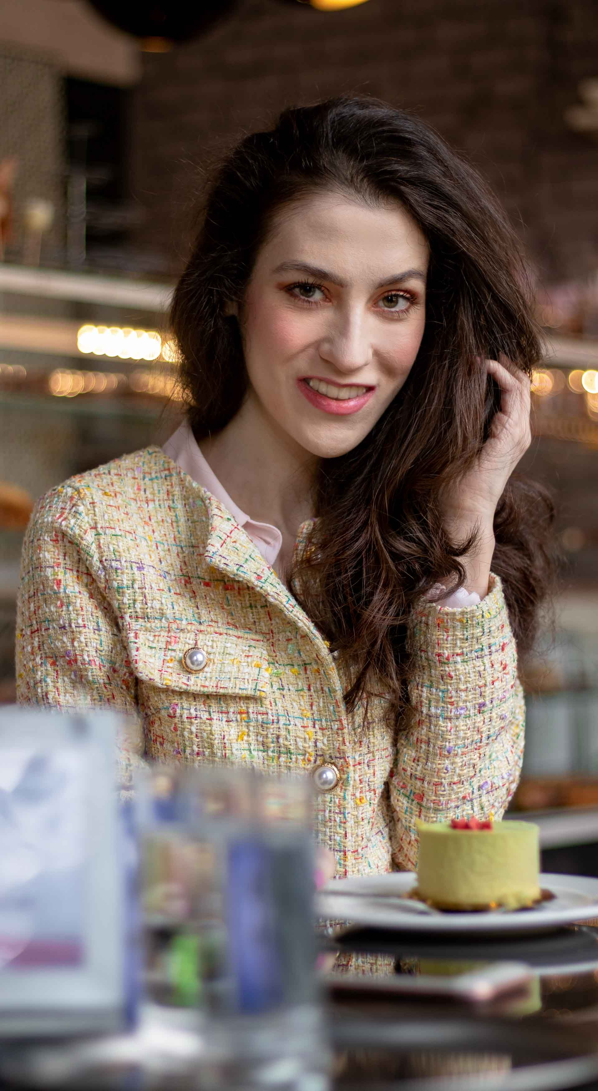 bb154e10d59 Must follow fashion blogger Veronika Lipar of Brunette from Wall Street  dressed in yellow tweed skirt suit