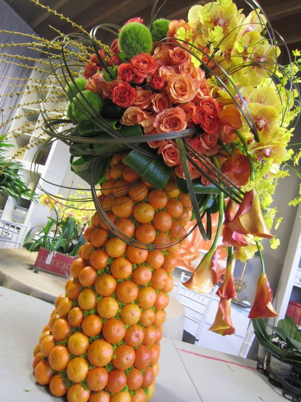 oranges centerpiece vibrant flowers orange green yellow ...