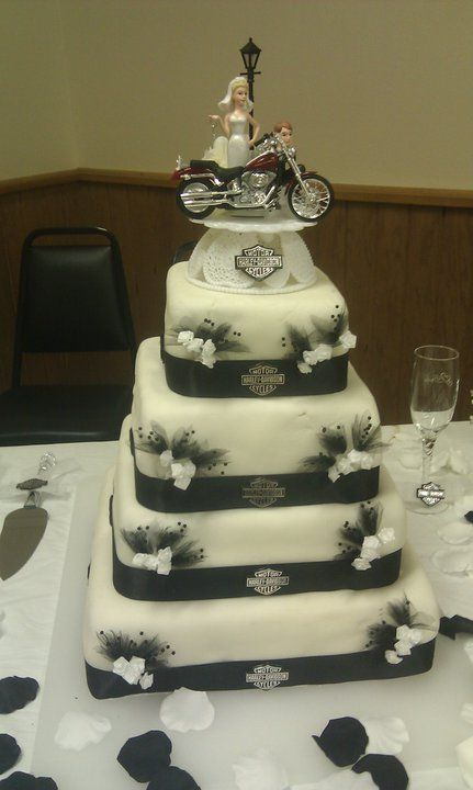 Harley wedding..Dennis favorite cake...ge likes this the best, but instead of the white flowers,  do the light pink roses!  This is it....I'll get t he topper and I can get Harley emblems...just tell me how many!