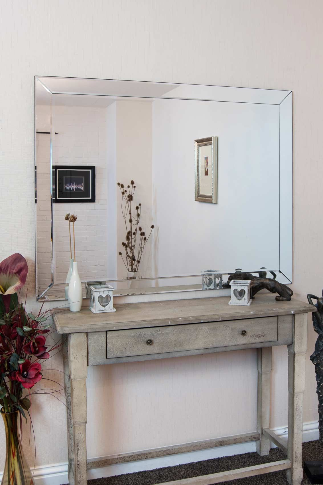 NEW and EXCLUSIVE to MirrorOutlet, this Rectangular Modern