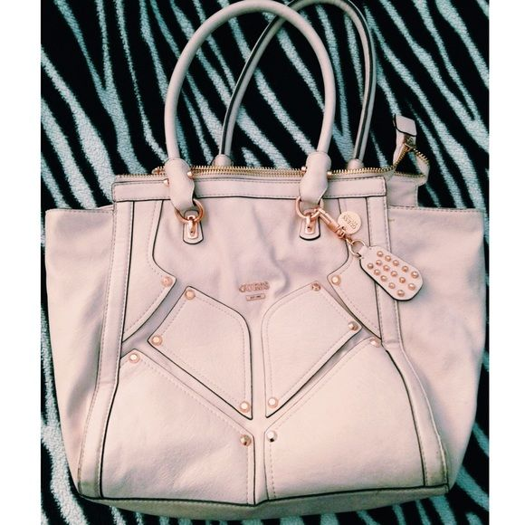 Guess blush pink rose gold studs shoulder bag Used but still in good condition. Blush colored with rose gold accents. Full zip across the top and several pockets for organization. ~*~I do not respond to offers made in the comments section. If you want to try to get a lower price, you can use the offer button~*~ Guess Bags