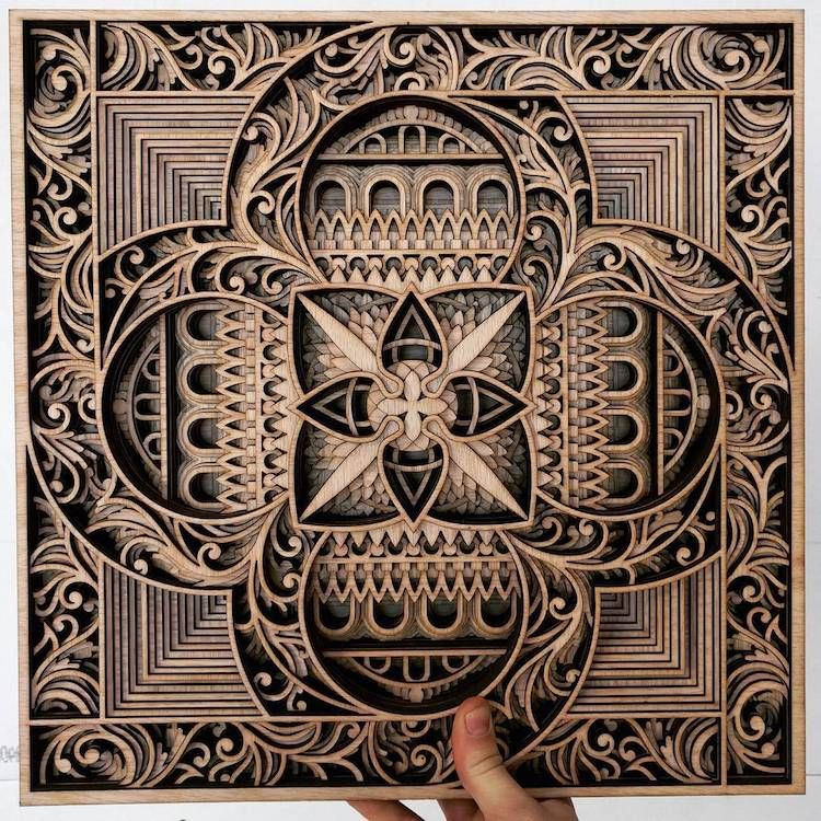 New laser cut wood sculptures embedded with intricate swirling designs