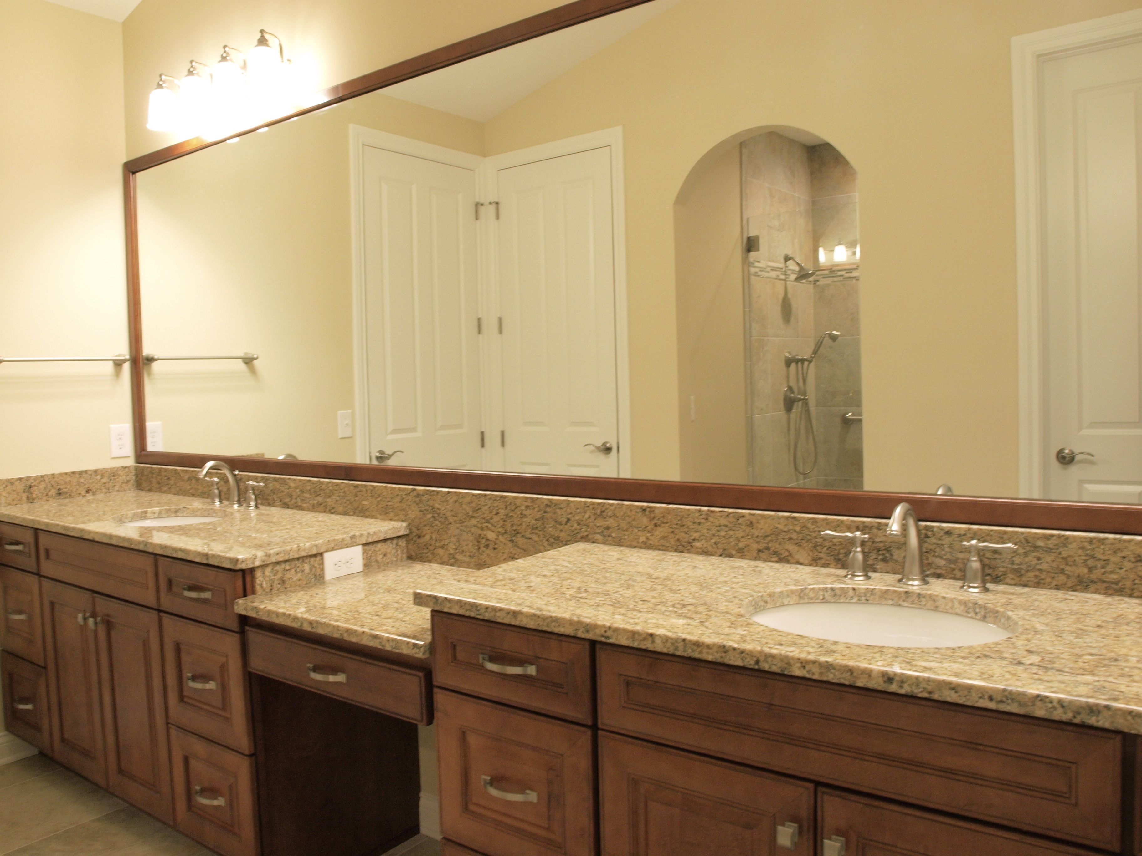 master bath, mirror molding, granite countertops, Kohler Caxton undermount sinks, Mid Continent cabinetry