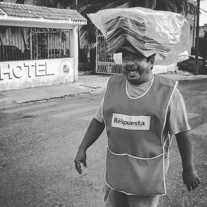 Every morning he delivers the paper to the village, screamung and shouting like a mad-man.