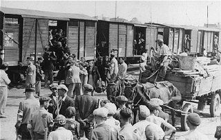 Jews from the Lodz ghetto are loaded onto freight trains for deportation to the Chelmno extermination camp. Lodz, Poland, between 1942 and 1944.    — National Museum of American Jewish History, Philadelphia