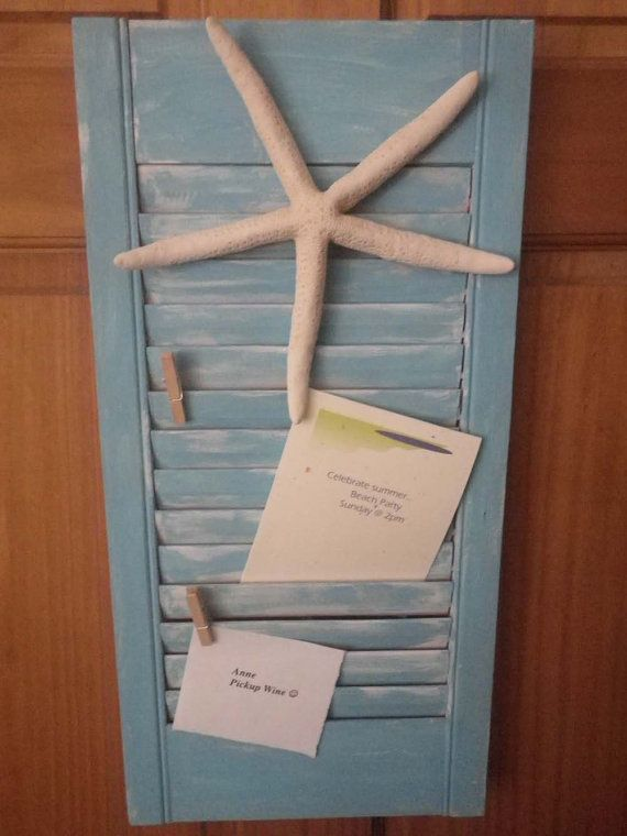 This 10 x 20 wooden shutter has been painted distressed Indian Turquoise with large Star Fish attached to watch over your reminders. Two small clothespins can hold your messages to remind you to get the wine and where the party is! Does not stand alone. Can be hung on the wall -placed in easel - or leaned.