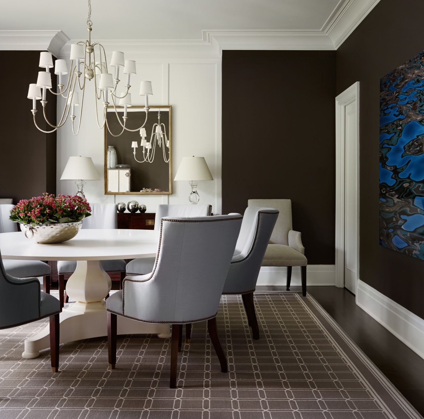 classic dining room with very dark brown walls light blue dining