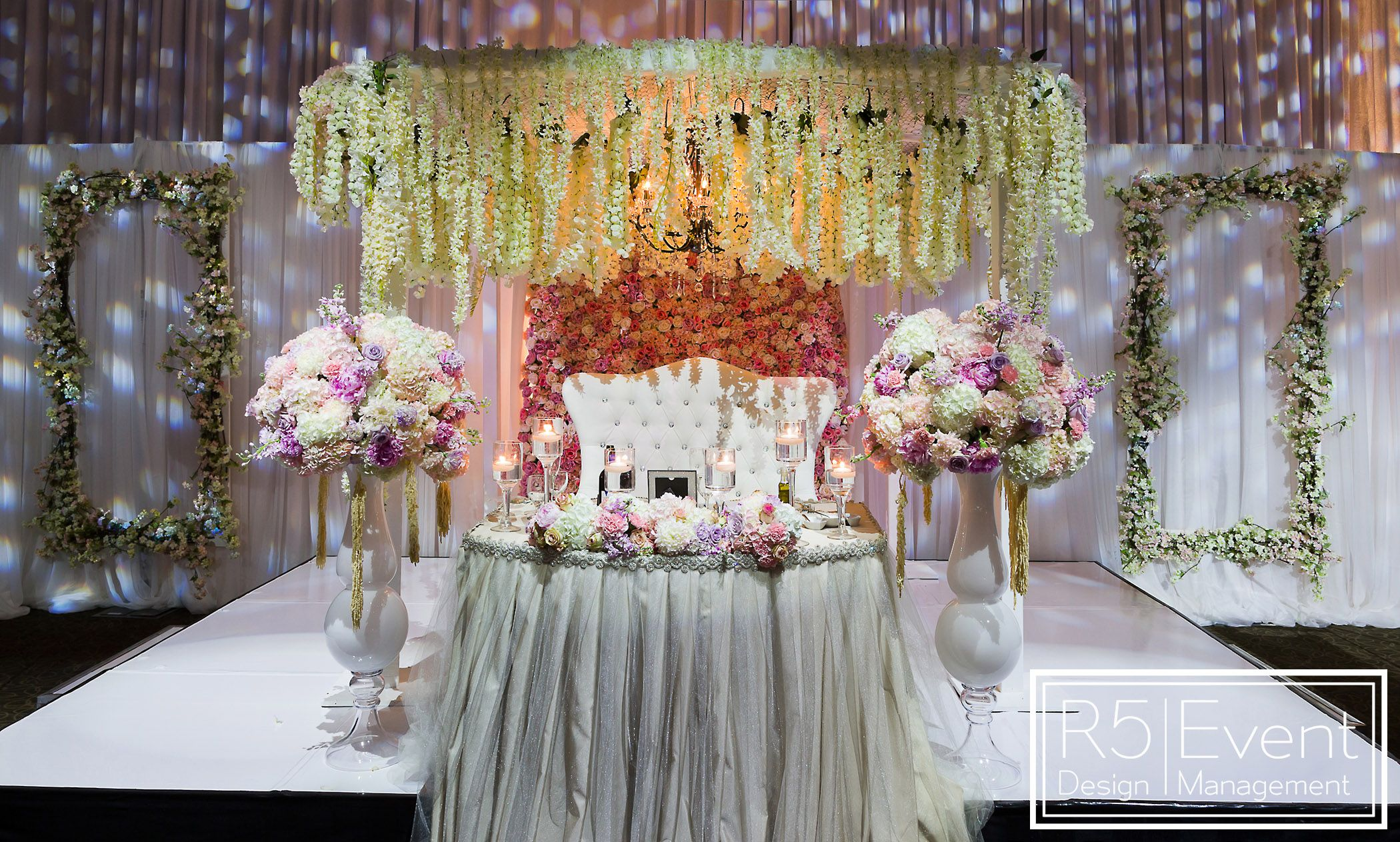 Elegant Head Table With Cascading Wisteria Roses