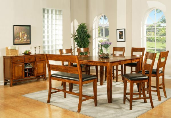 Today's trend is toward counter-height dining with eco-friendly wood, bench seating, and the distinctive styling of our Roanoke Gathering Set.  Available at Just Cabinets Furniture & More and online at JustCabinets.com