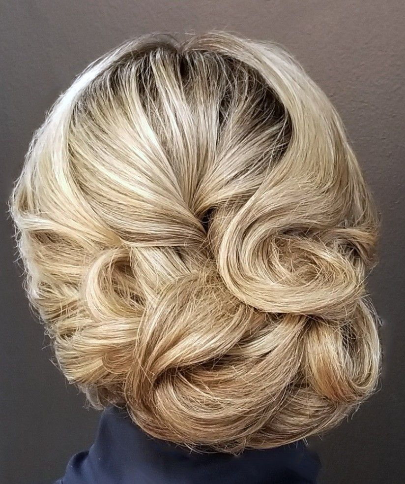 chic and sophisticated smooth looping updo by luminous