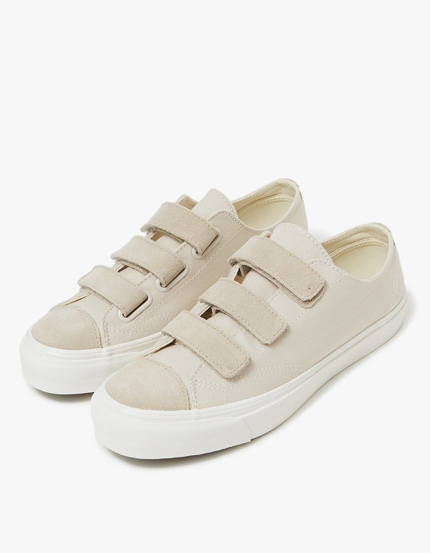 8788c1446a9c44 Minimalist low top shoe from Vault by Vans in Moonbeam and Grey. Three  strap Velcro closure. Reinforced toe cap. Tonal stitching.