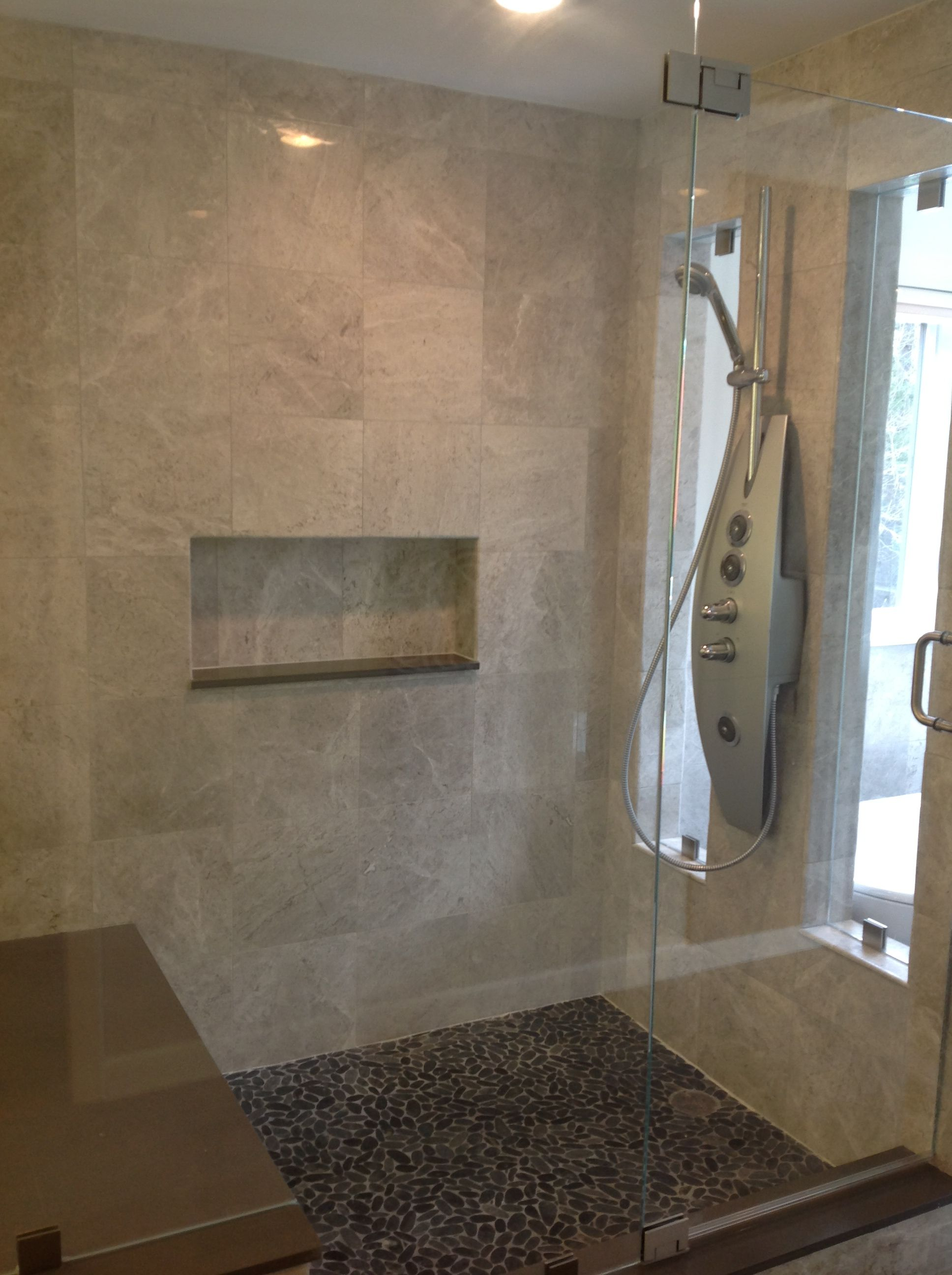 interesting - shower niche lined in different stone tile