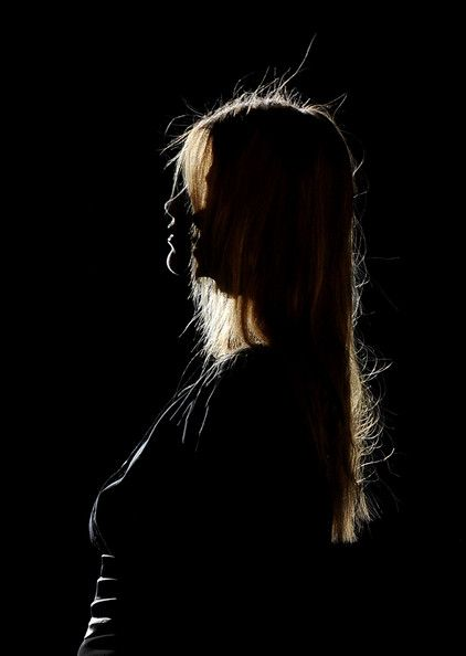 A backlit model walks the runway in the Sita Murt fashion show during the Cibeles Madrid Fashion Week Autumn/Winter 2011 at the Ifema on February 21, 2011 in Madrid, Spain.