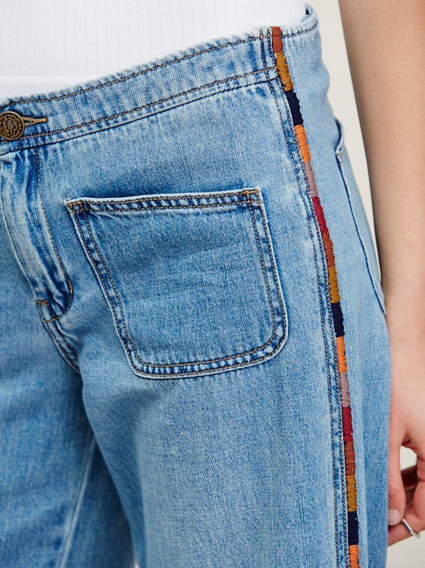 Viola Embroidered Wide Leg | Super soft and lightweight jeans in a mid-rise with colorfully embroidered side seams. This retro pair features patch pockets and raw detailing on the hem. No belt-loops on the waistband and a button closure and zip fly.