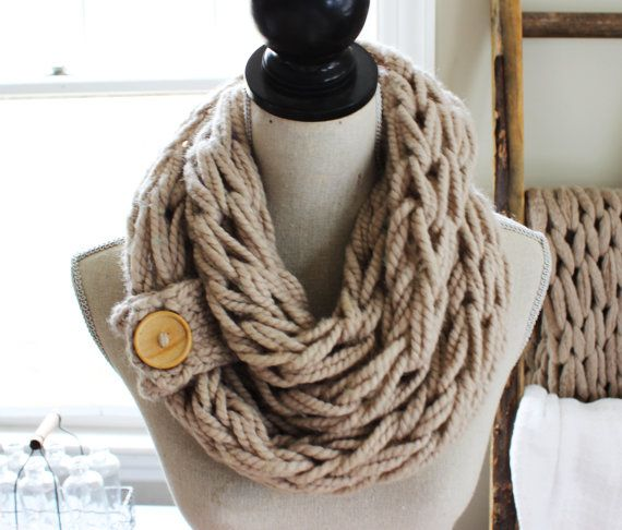 A Simple Double Wrap Arm Knit Infinity Scarf Featuring A