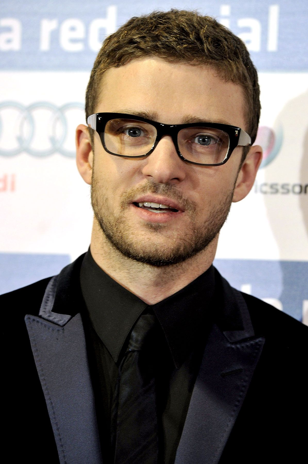 8ec9820a43e Davis Vision - Justin Timberlake looks handsome in super-thick black specs.