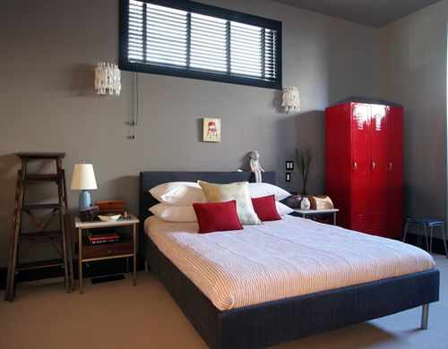 Amazing A Modern Bedroom With Grey Walls And Beautiful Red Accents.