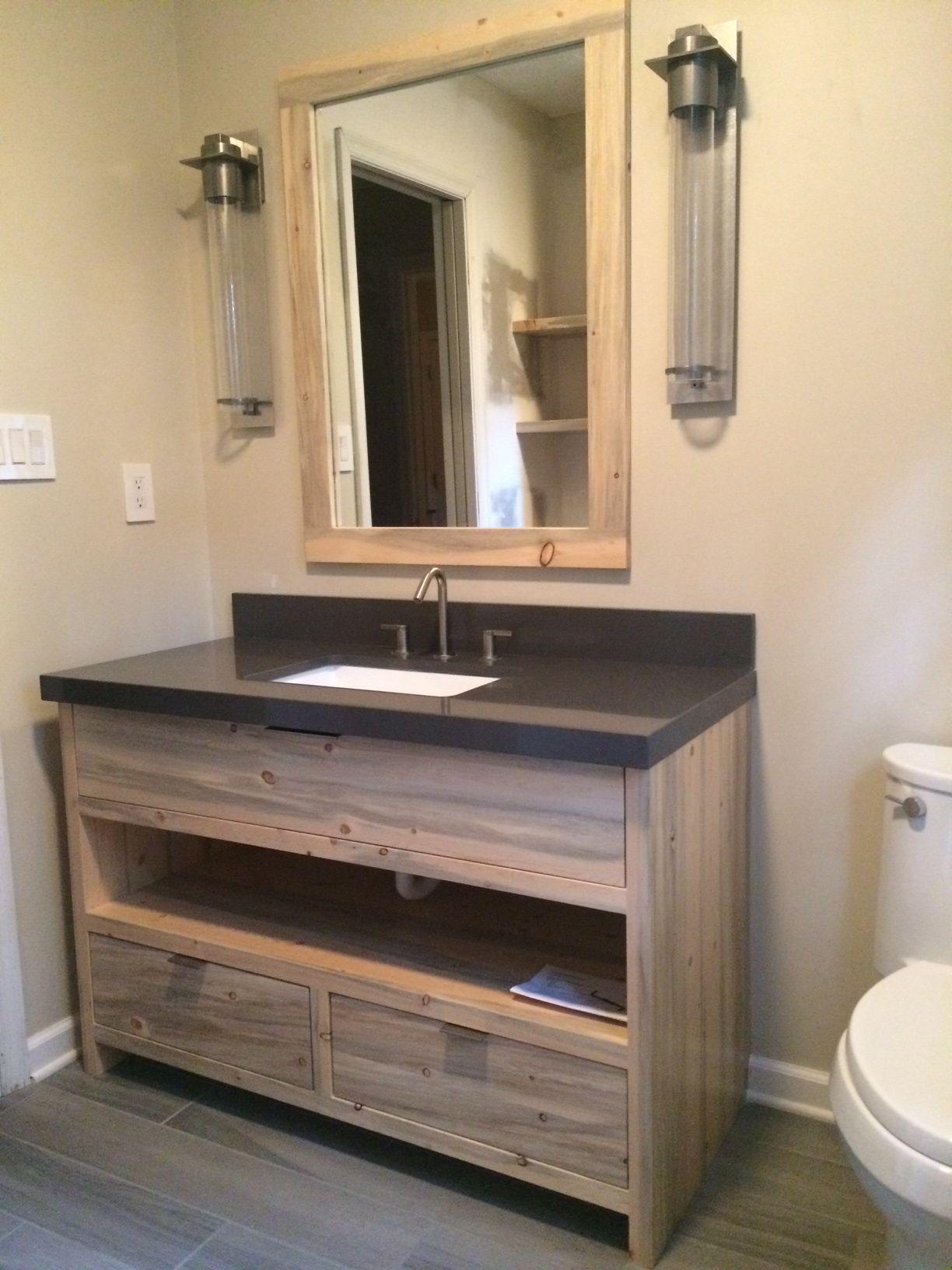 A custom beetle kill pine bathroom vanity built for a home in