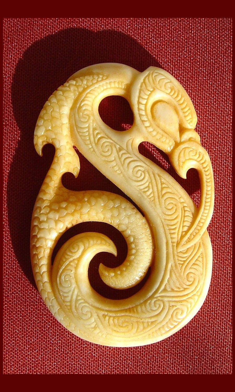 Bone and jade carving koru pitau manaia taniwha hei