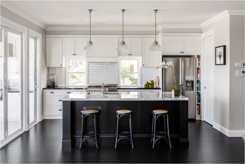 Minimalist Kitchen Island Black Painted Oak Hardwood Flooring White Quartzs Countertop Round Fa Black Kitchen Island Minimalist Kitchen Design Kitchen Flooring