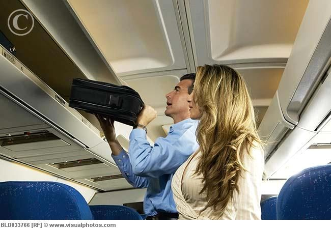 Help People Put Their Bags Into The Overhead Compartment Economy