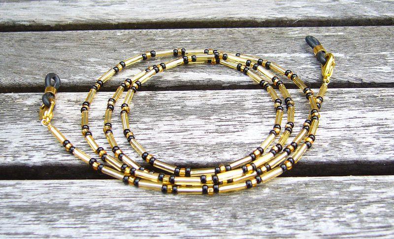 Brillenkette / Brillenband gold - schwarz von Unbehauen - Schmuckdesign auf DaWanda.com