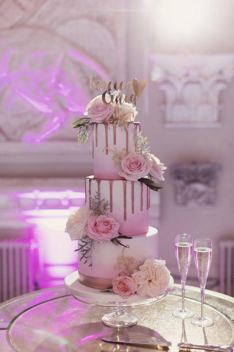 Gorgeous wedding cake with name cake topper drips u beautiful