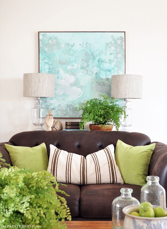 Beautiful Accessorizing Of A Brown Leather Couch In