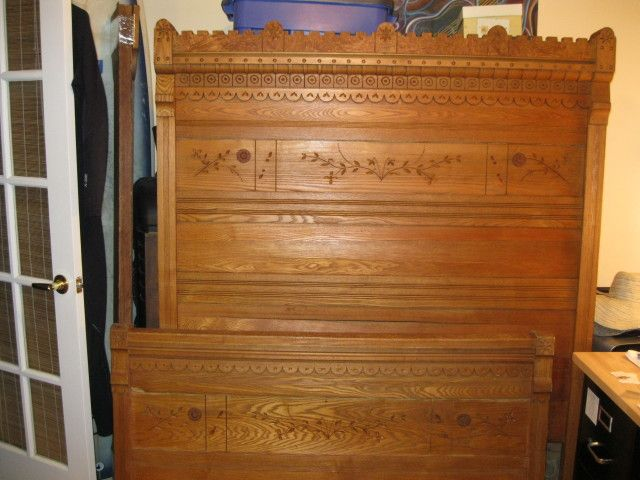 Victorian Eastlake child s bed in chestnut  Circa 1900  The carving is  called incise carving. Victorian Eastlake child s bed in chestnut  Circa 1900  The