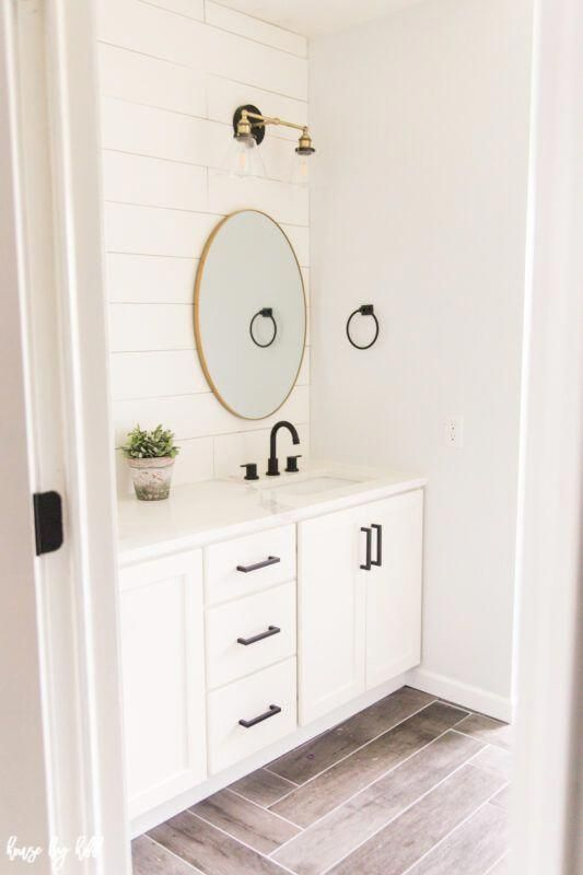 Photo of Renovated Guest Bathroom with Shiplap and Brass Light Fixtures #bathroomlightfix …
