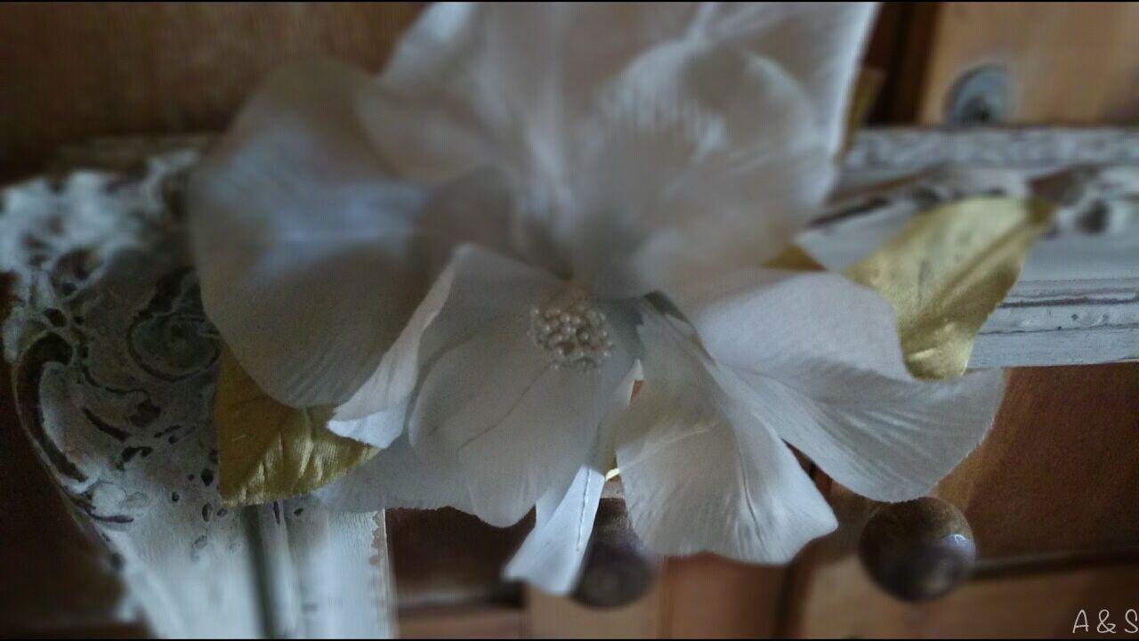 Silk flower and antique frame