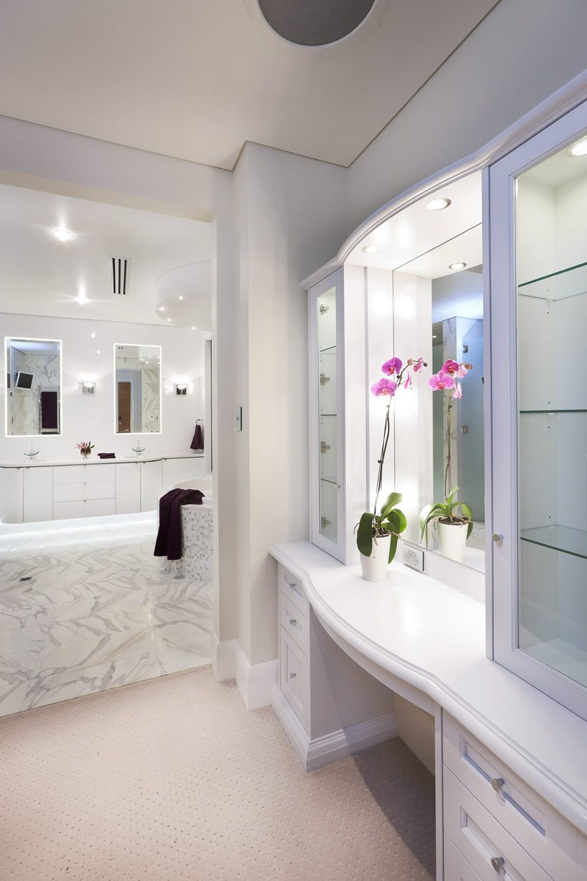 All white luxurious master ensuite with custom designed cabinetry ...